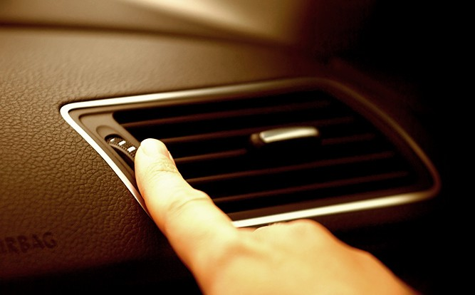 driver-adjusting-heating-cooling-vent